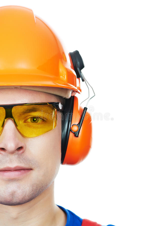 Free Builder In Hard Hat, Earmuffs And Goggles Royalty Free Stock Photography - 22004107