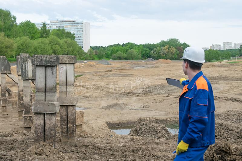 Builder inspects a building site for an artificial lake royalty free stock images