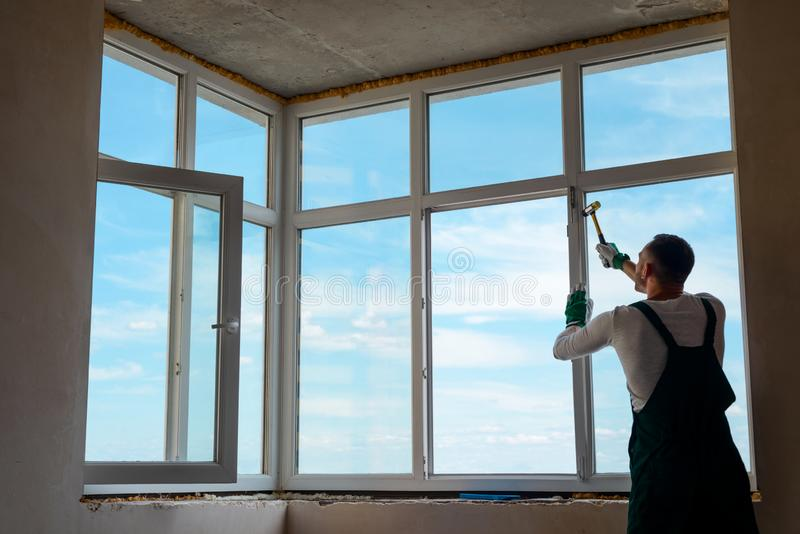 Builder is installing a window. stock image