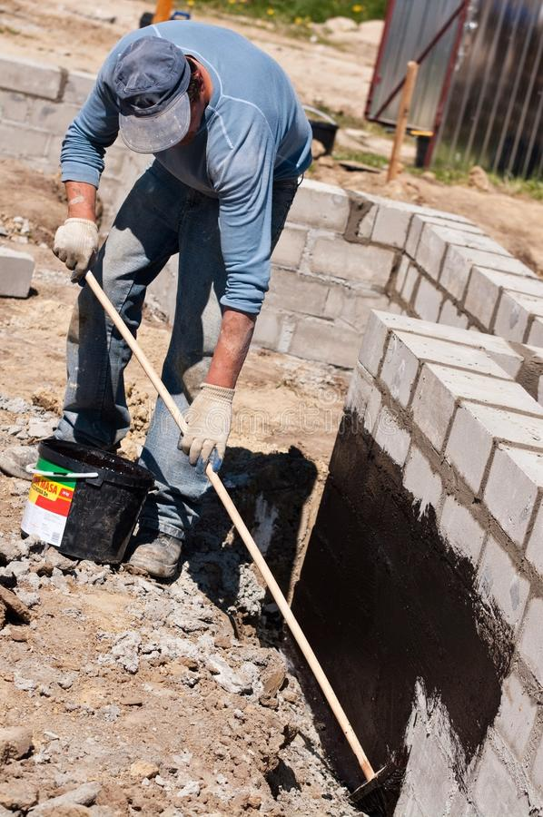 Builder insulating foundations stock images