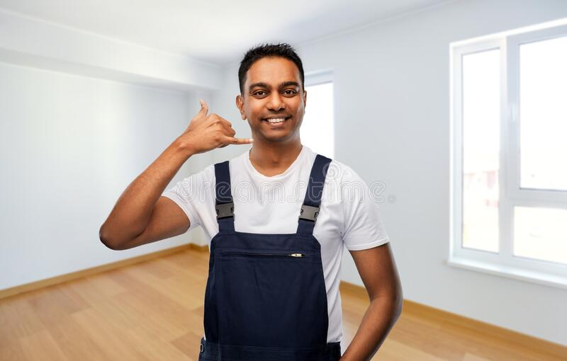 Builder making phone call gesture at new home stock photos