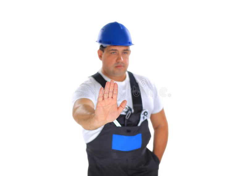 Builder Making Stop Sign Stock Photo