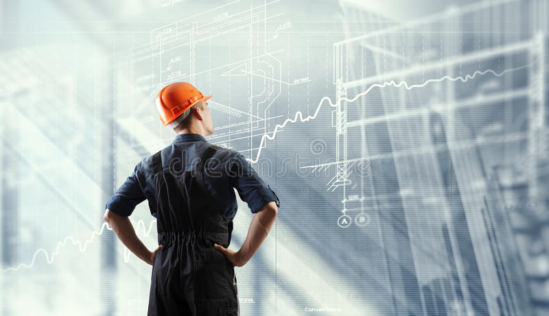 Builder man and media interface . Mixed media royalty free stock photo