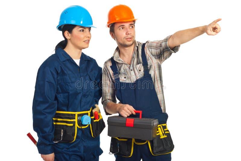 Builder man pointing away royalty free stock photo