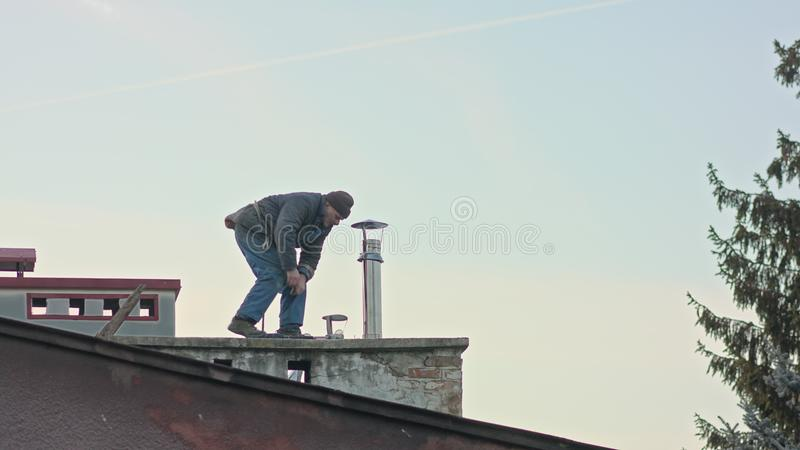 Builder Man with Screwdriver Machine. Builder man worker screwing self tapping with screwdriver machine during roofing construction works royalty free stock photos