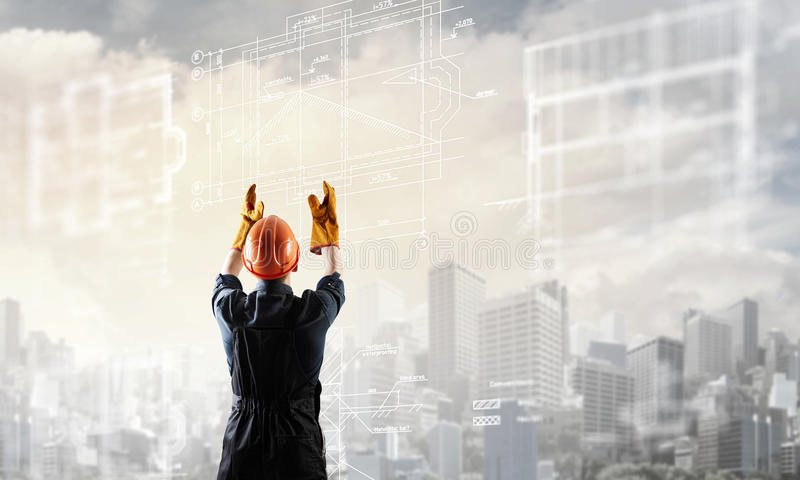 Builder man using media interface royalty free stock photo
