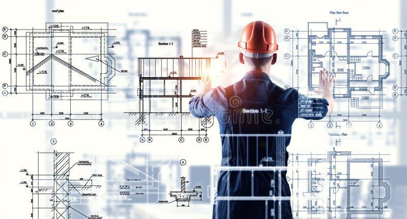 Builder man using media interface . Mixed media royalty free stock photography