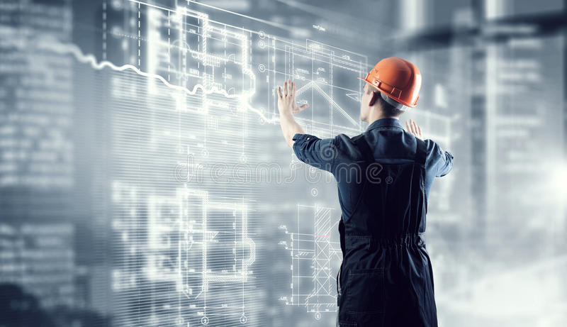 Builder man using media interface . Mixed media royalty free stock image