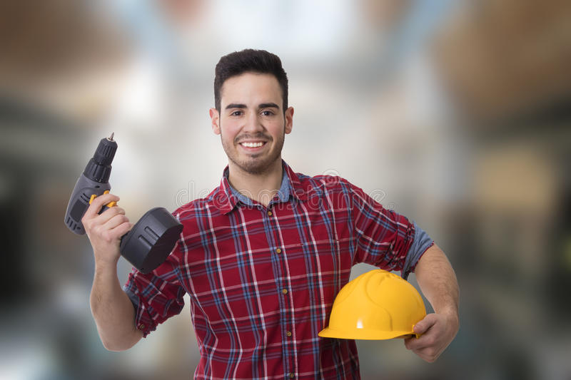 Builder man, workers. Young smiling with drill or screwdriver, bricolage and repair man stock photo