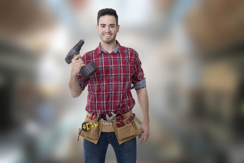Builder man. Young smiling with drill or screwdriver, bricolage and repair man stock images