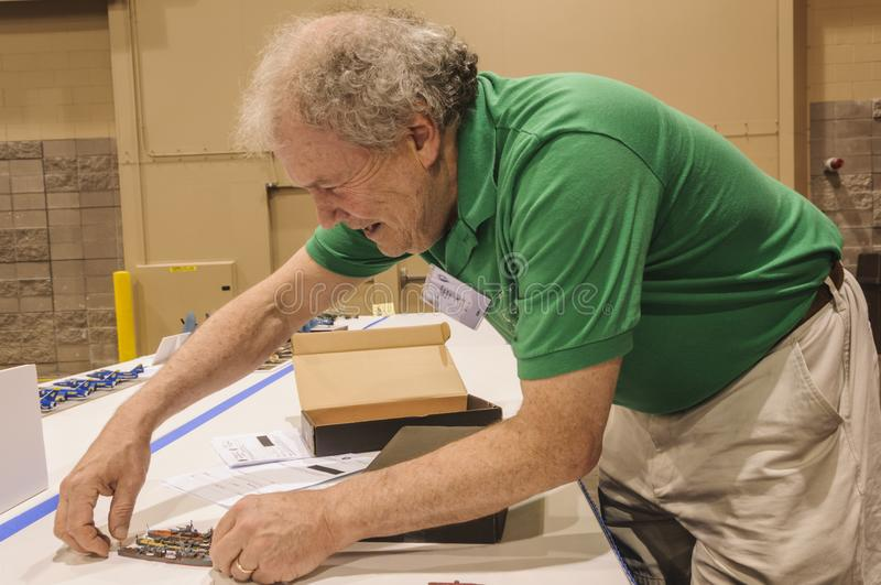 Builder of ship models displays at the Modeling Convention in Phoenix, Arizona. The builder of Models of military destroyers is displaying his models at the 2018 stock photo