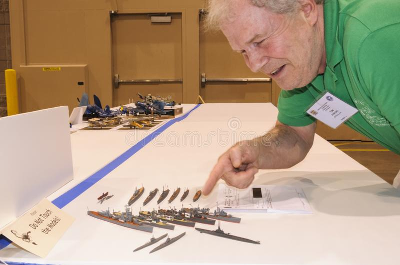 The builder of Models of military ships displays at the Modeling Convention in Phoenix, Arizona. The builder of Models of military ships arranges the display of royalty free stock images