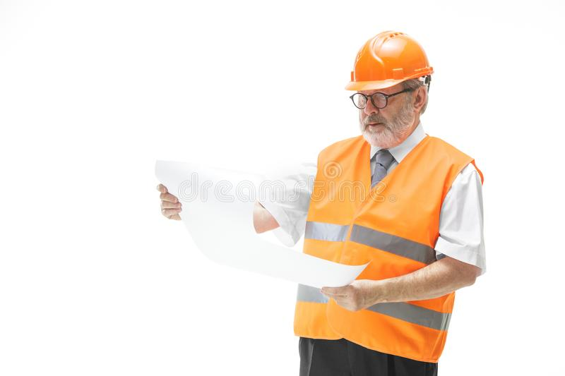 The builder in orange helmet isolated on white royalty free stock photos