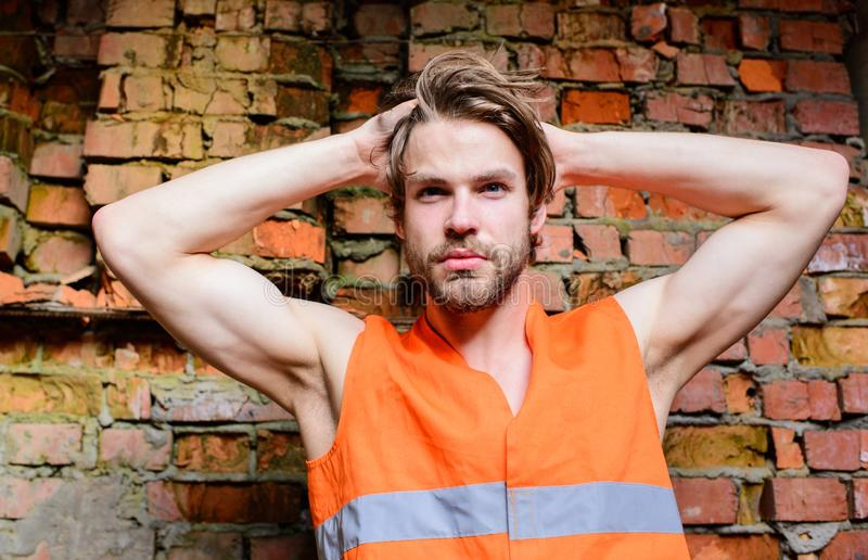 Builder orange vest work construction site. macho foreman. Builder muscular arms macho dream of every woman stock image