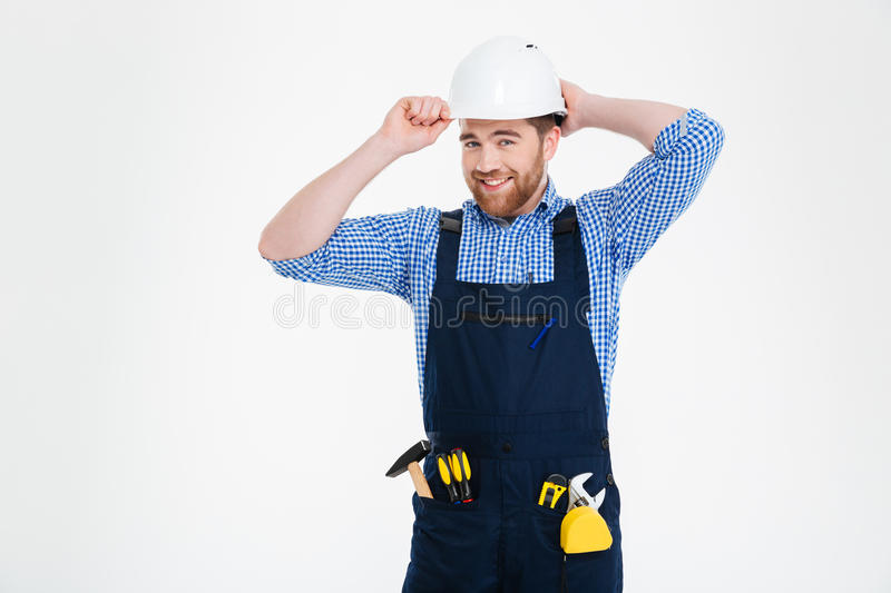 Builder in overall and helmet royalty free stock images