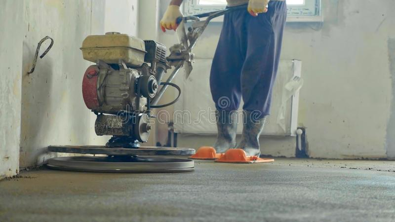 Mechanized grout screed concrete floor close-up stock photos