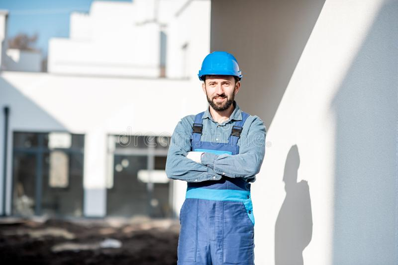 Builder portrait on the construction site royalty free stock photo