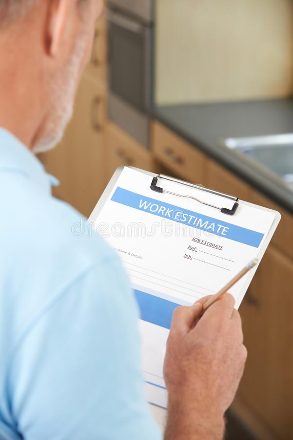 Builder Preparing Estimate For Home Improvement royalty free stock images