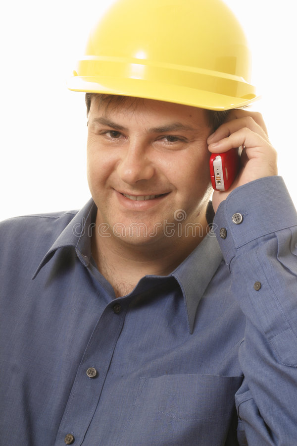 Builder Project Manager Tradesman. Builder or tradesment using mobile phone royalty free stock photo