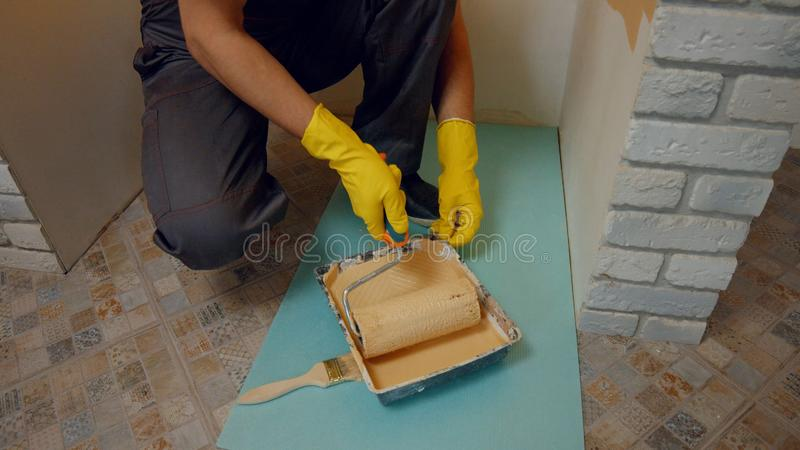 Builder ready to paint the walls. royalty free stock images
