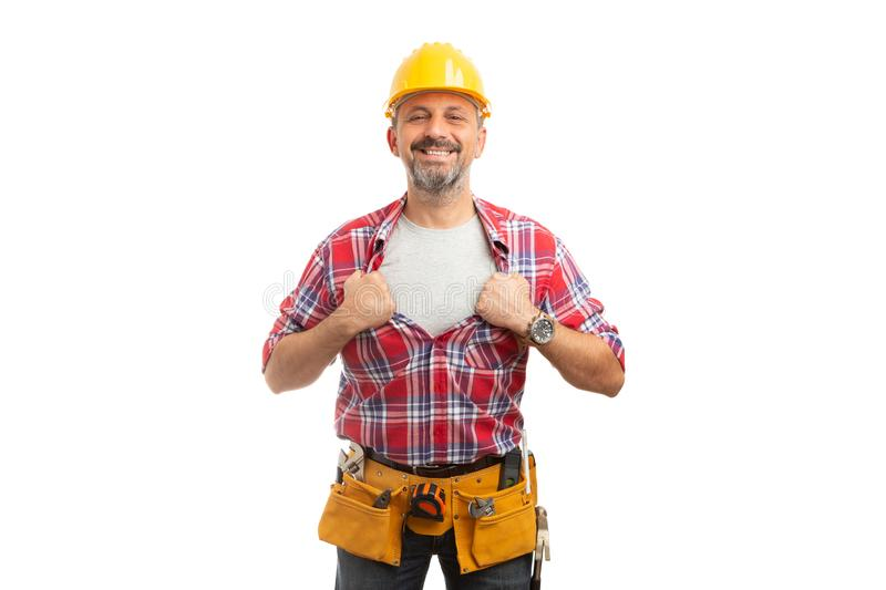 Builder revealing copyspace under shirt royalty free stock photography