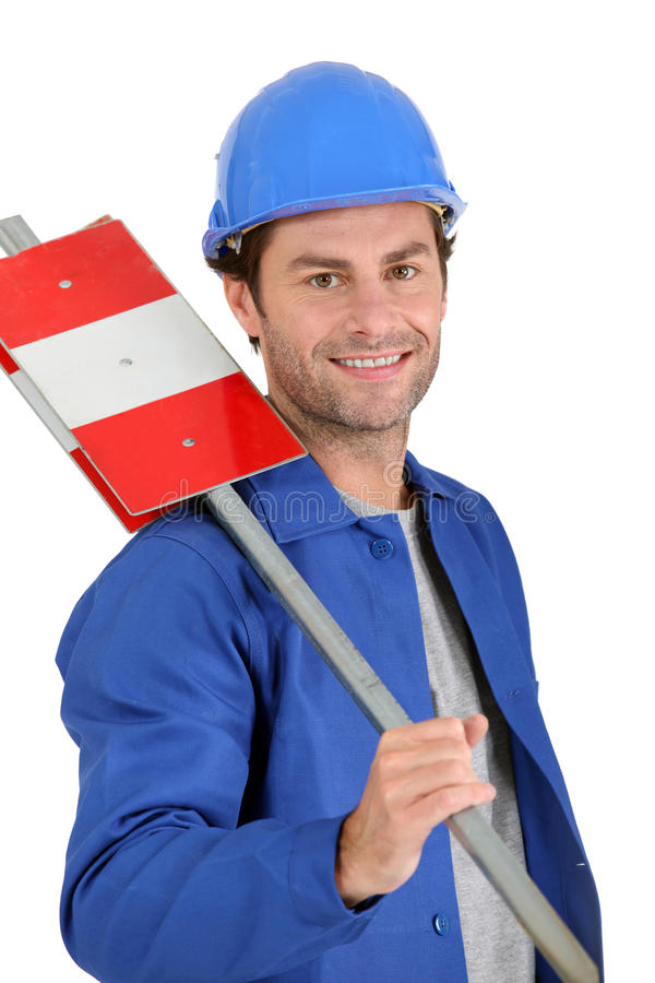 Builder With Road Sign Royalty Free Stock Image