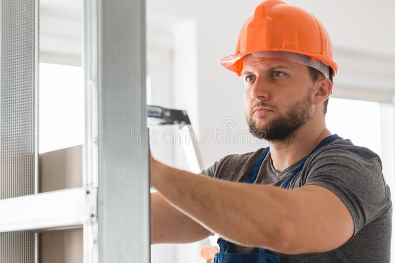 Builder setting the wall stock image