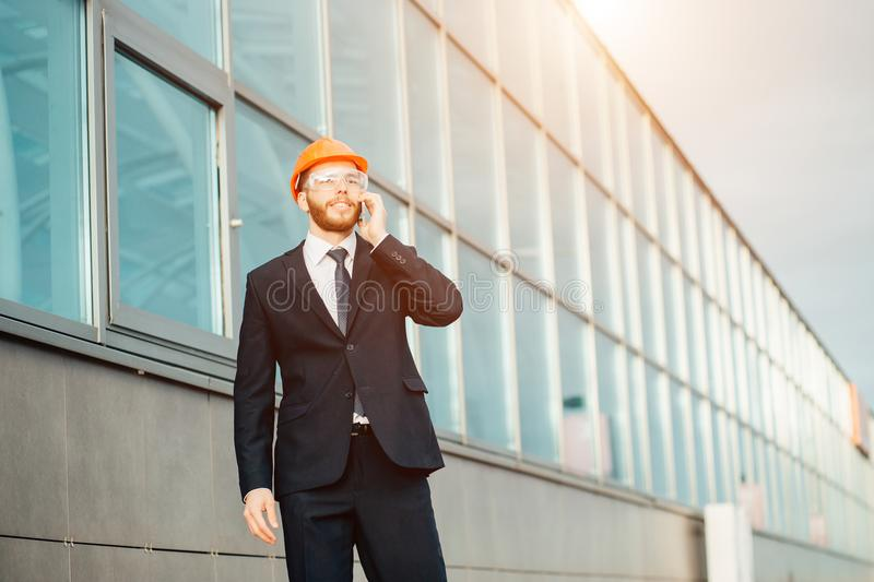 Builder On Site Using Mobile Phone stock photos