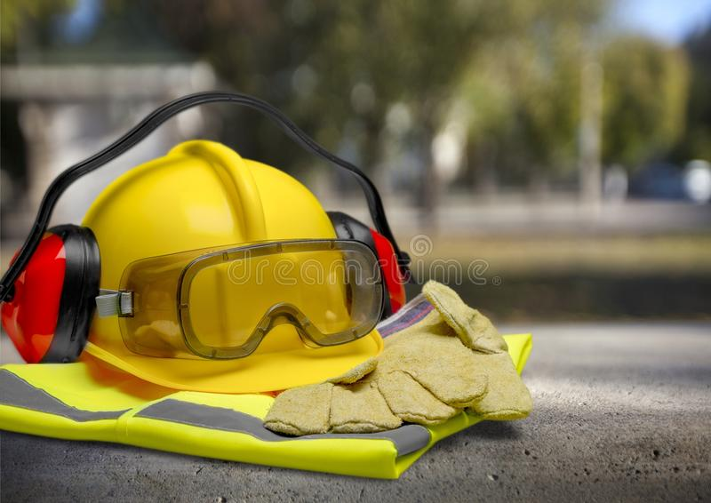 Builder staff laying on asphalt witgh blurred stock photo