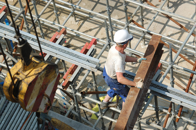 Builder with steel beam royalty free stock photography