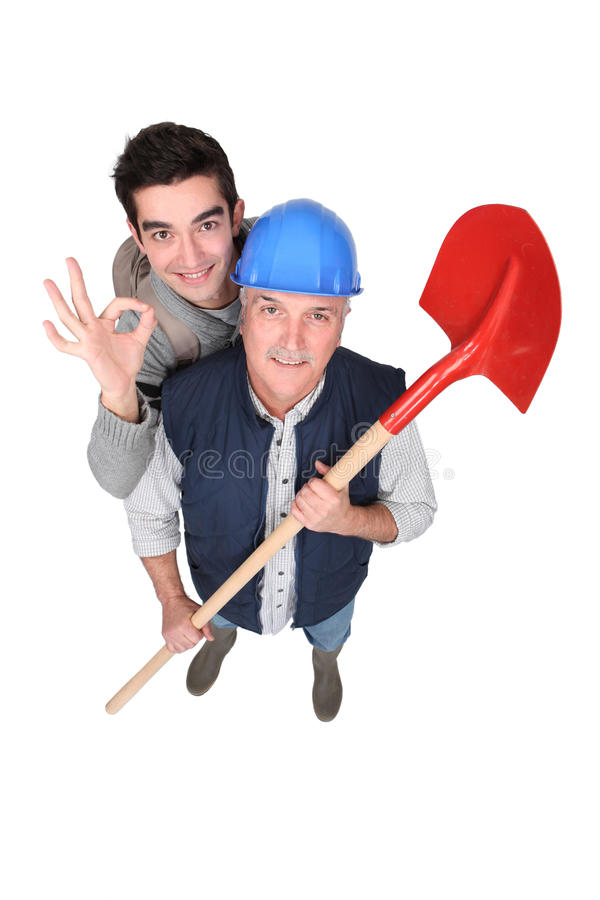 Builder stood with young apprentice royalty free stock images