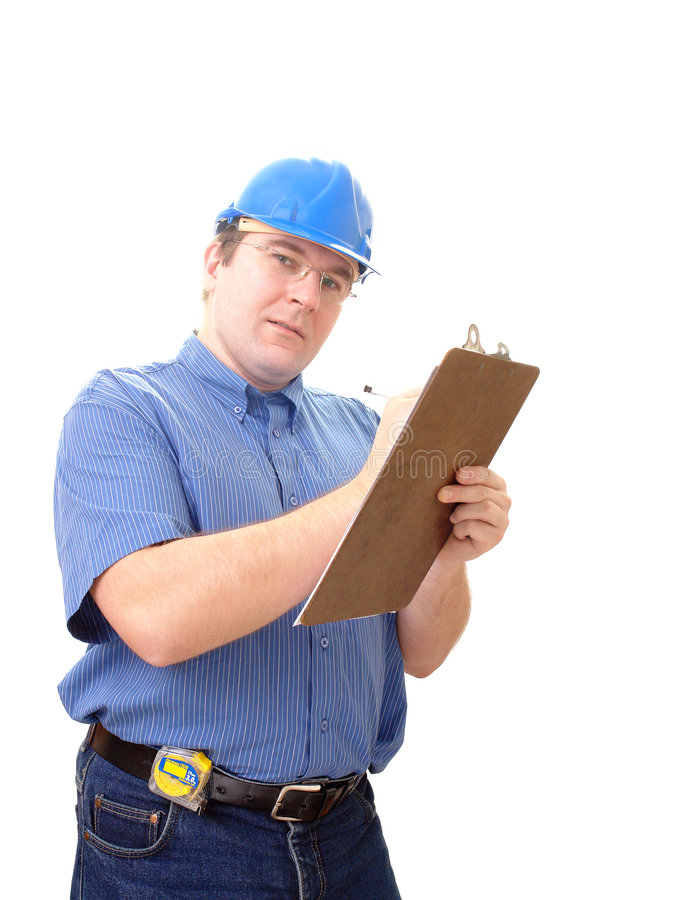 Builder taking notes stock photo