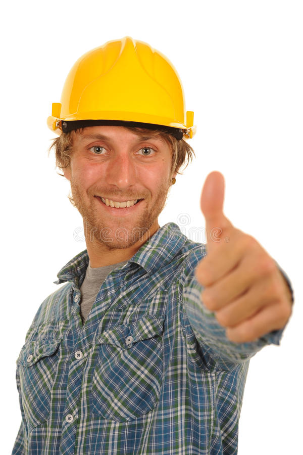 Builder with thumb up. Handsome young builder in hard hat with thumb up; isolated on white background stock photo