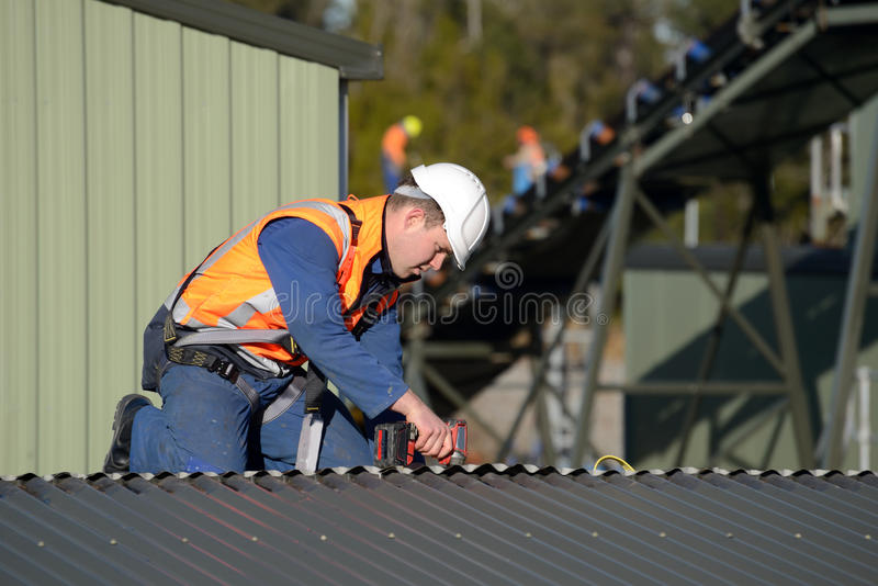 Builder on top stock images