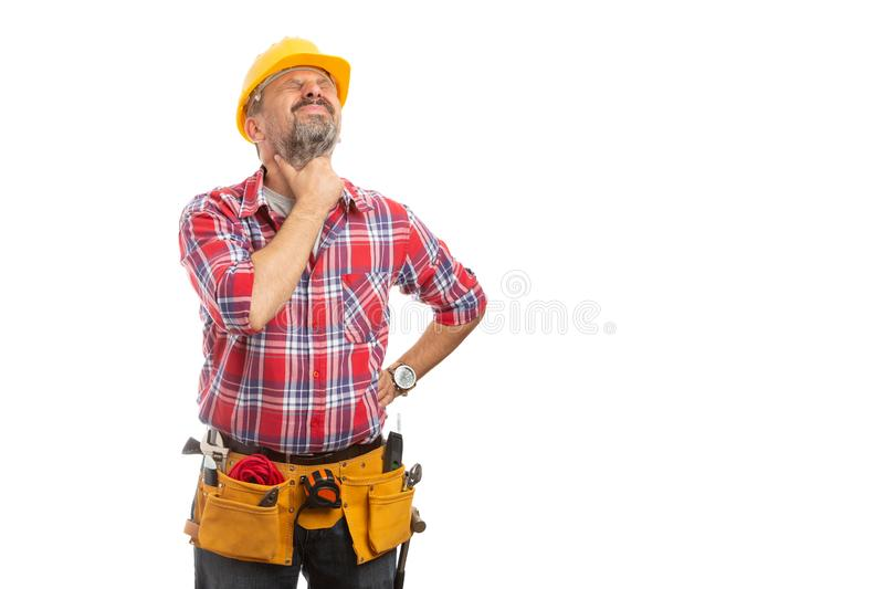 Builder touching neck as throat ache. Sick builder touching neck as throat ache caused by cold or flu isolated on white background royalty free stock image
