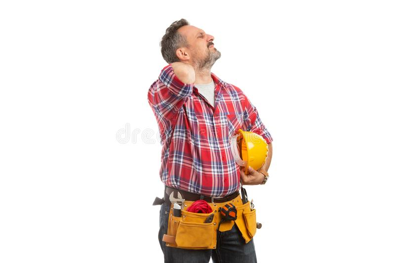 Builder touching painful back of neck. With hand as stretching from physical effort isolated on white background royalty free stock images