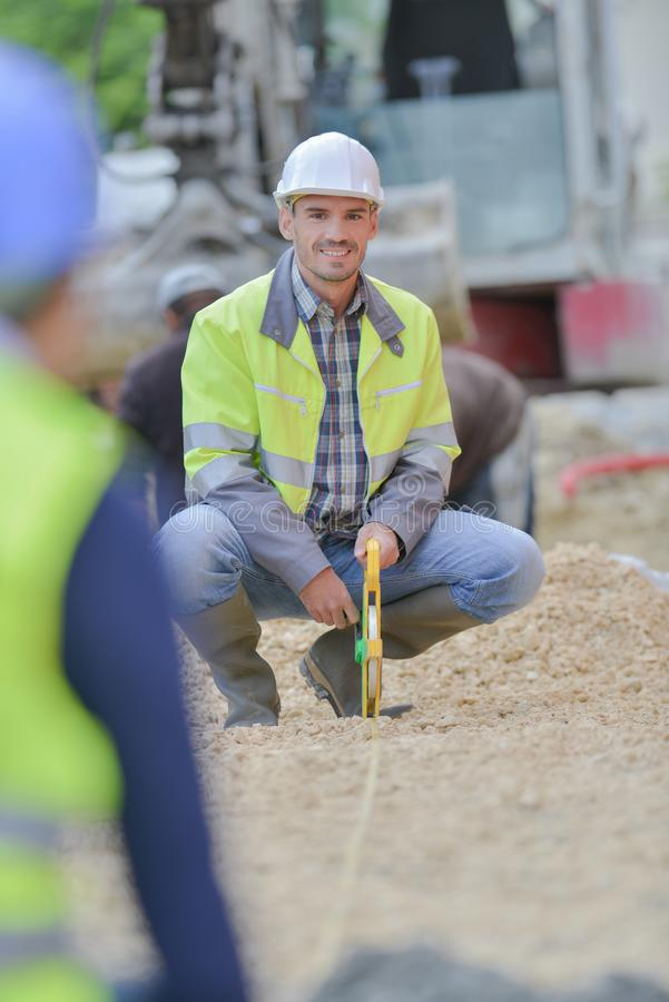 Builder with transit equipment at construction site outdoors stock image