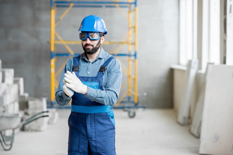 Builder in uniform indoors royalty free stock image