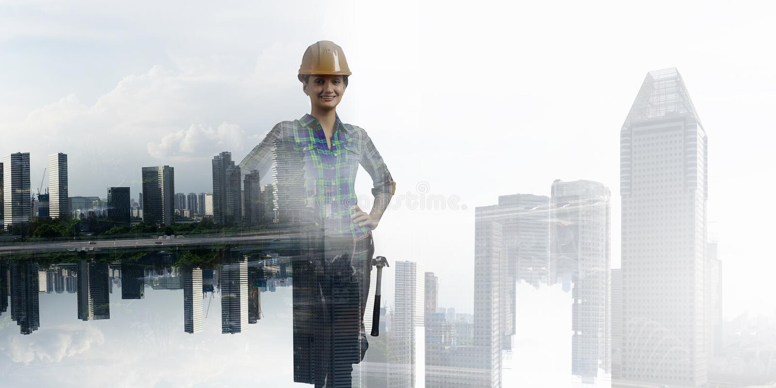 Builder woman against cityscape royalty free stock photo