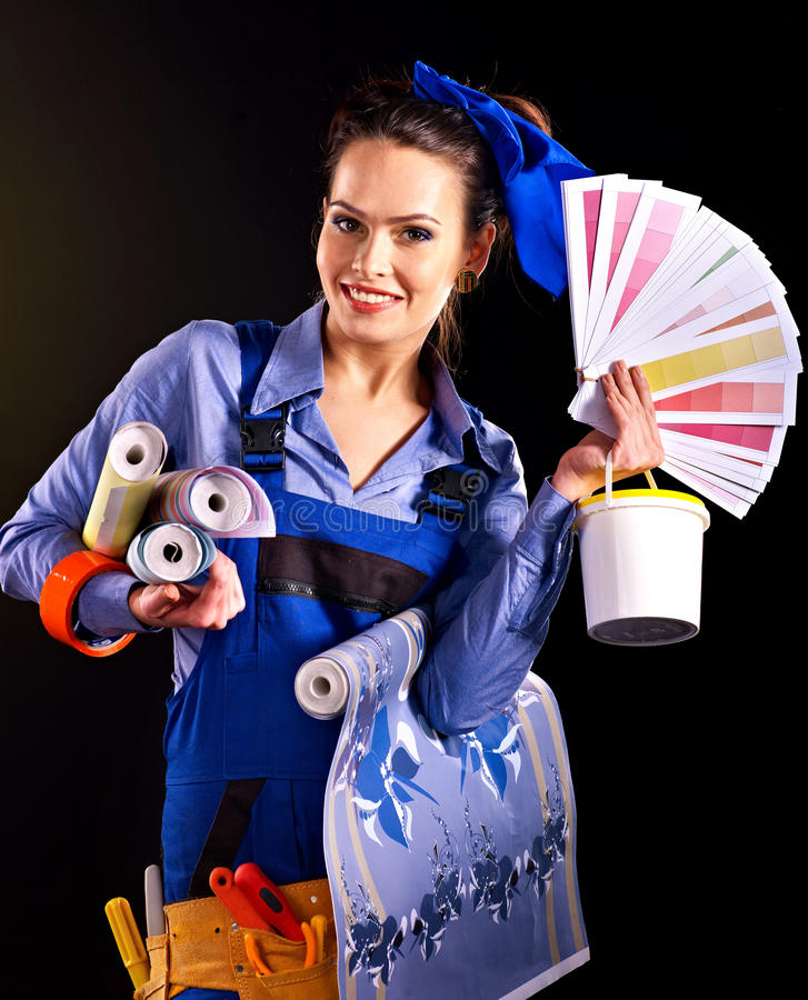 Builder woman with wallpaper. Builder woman with roll wallpaper. Fashion stock photography