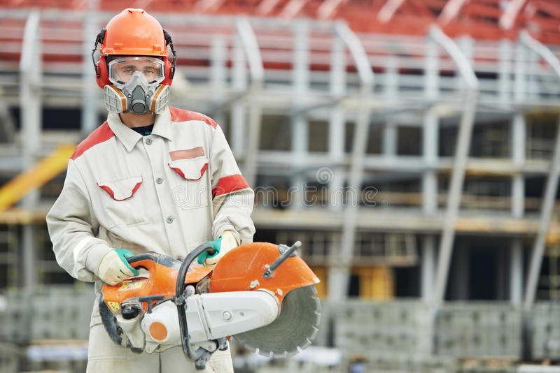 Builder worker with disc cutter royalty free stock photo