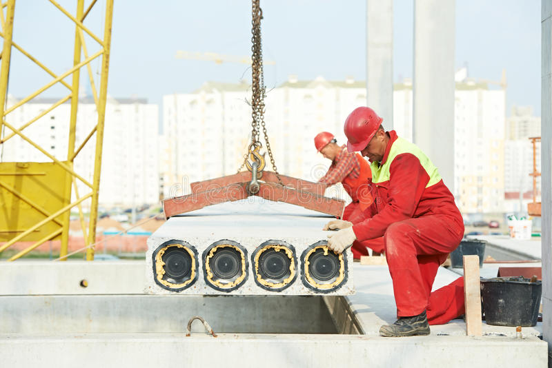 Builder worker installing concrete slab royalty free stock images