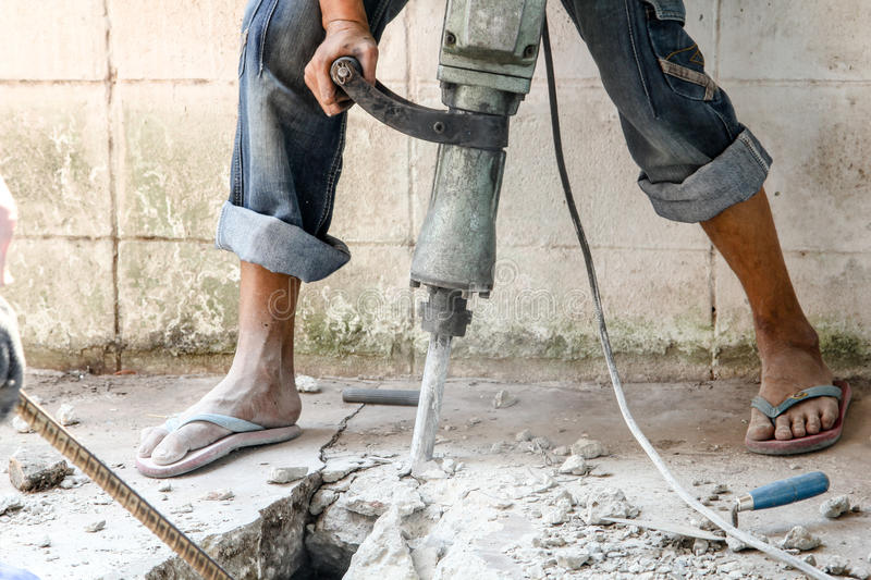 Builder worker with pneumatic hammer drill. Equipment at construction site stock photography
