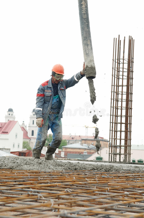 Builder Worker Pouring Concrete Stock Photos