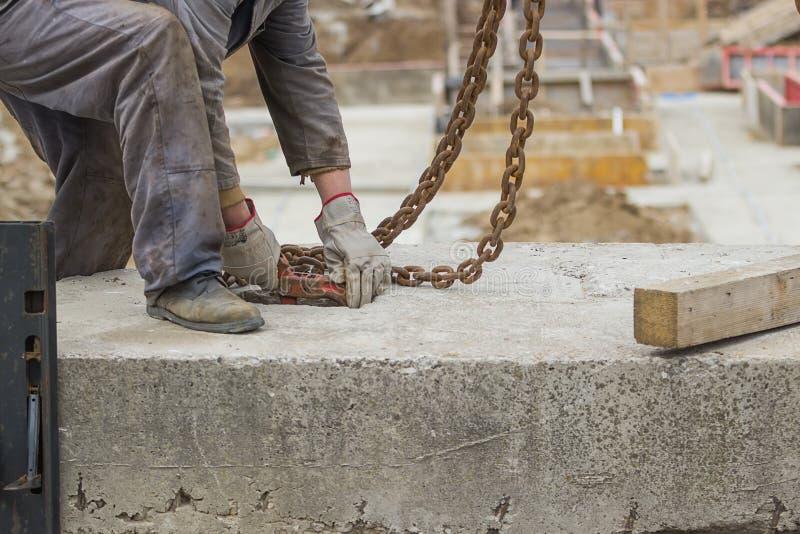 Builder worker preparing concrete profile for crane lifting 2 stock image