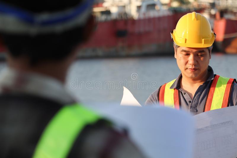 Builder worker in uniform with safety belt at construction site royalty free stock images