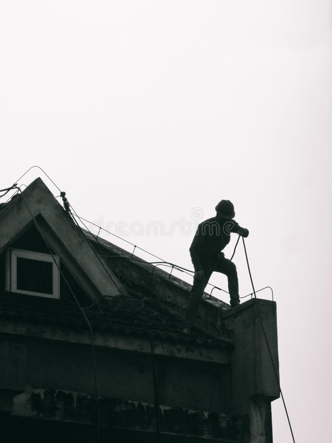 Builder or worker working on the roof royalty free stock photo
