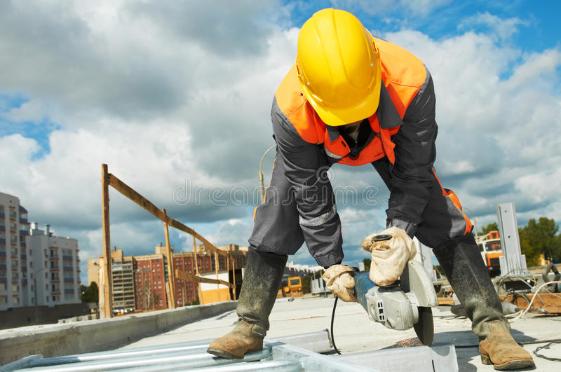 Builder working with cutting grinder royalty free stock photography