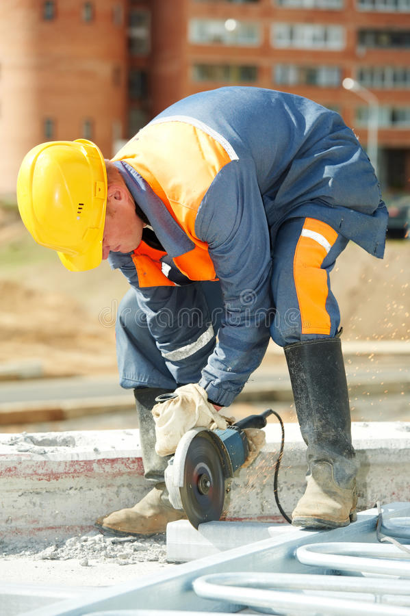 Builder working with cutting grinder stock photos