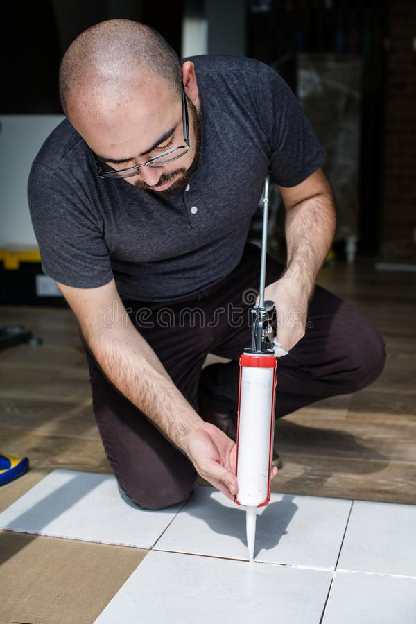 A builder working on tiles royalty free stock photos